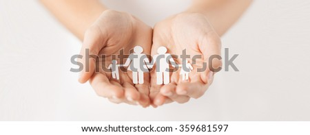 woman hands with paper man family