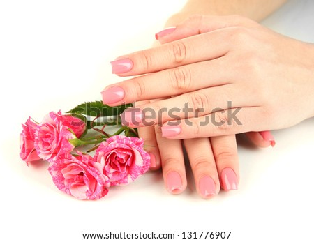 Woman hands with pink manicure and flowers, isolated on white