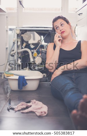 Woman has a leak in the kitchen