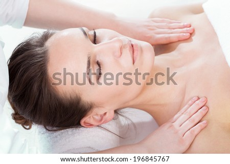 Woman having body massage on isolated background