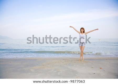 woman having fun by the beach