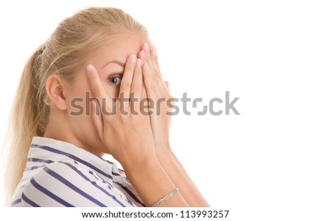 Woman hide her face through fingers