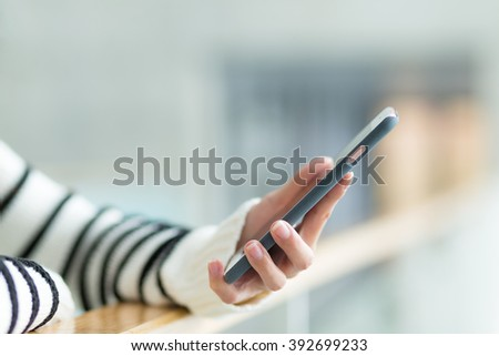 Woman hold with smart phone