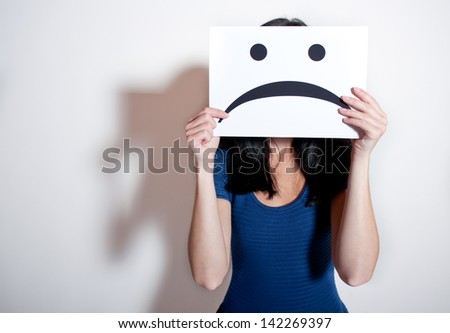Woman holding a blank paper with sad face