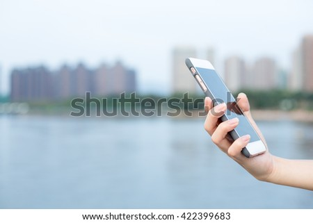 Woman holding a cellphone
