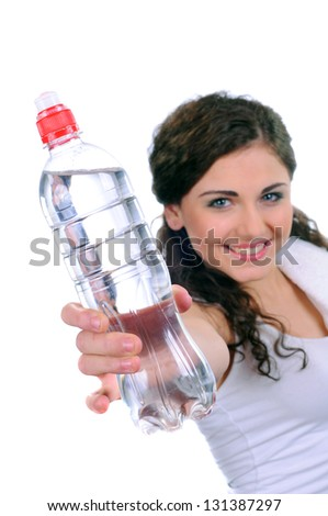 woman holding bottle with water over white background