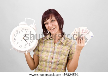 Woman holding clock and money, in gray background
