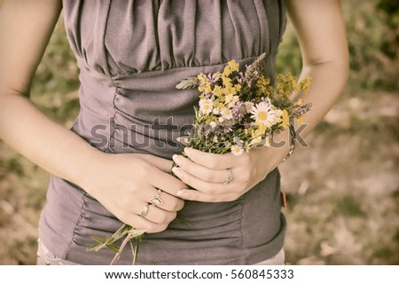 Woman holding wildflower bouquet