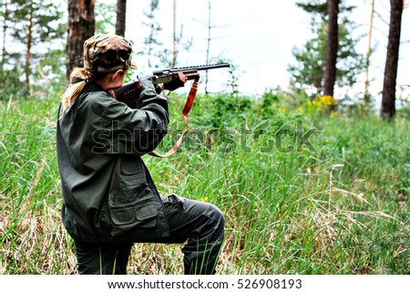 Woman hunter in the woods