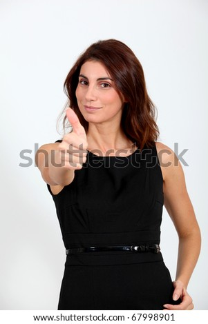 Woman in black dress with positive look