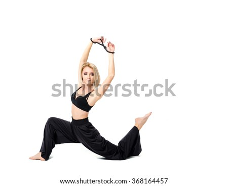 Woman in black suit dance on the white background
