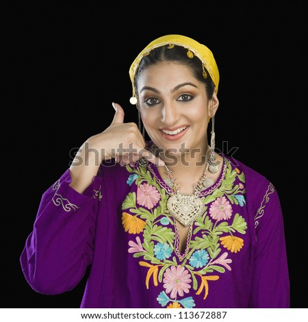 Woman in Kashmiri dress showing call me gesture