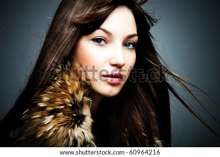 woman in leather jacket with fur portrait studio shot