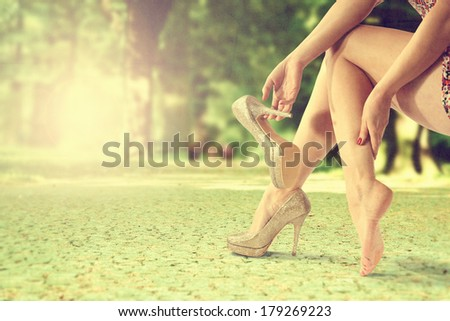 woman in park and gold shoes