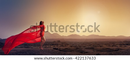 woman in red basking in the morning sun