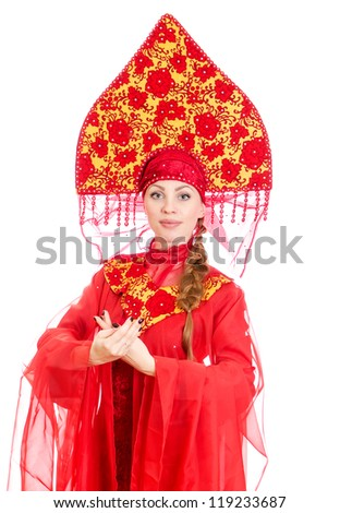 Woman in russian traditional clothes. Isolated on white.