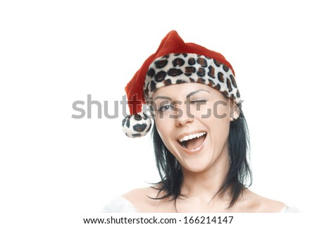 Woman in Santa Claus costume winking and laughing on a white background