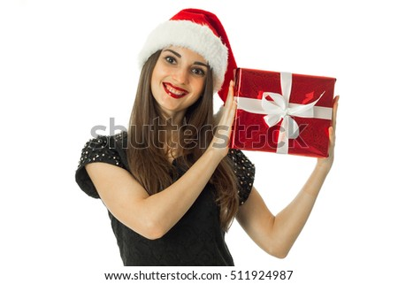 woman in santa hat smiling with red gift in hands isolated on white background