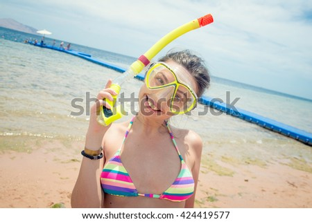 woman in snorkel pleased with life