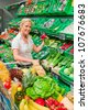 woman in the purchase of fresh fruits and vegetables in a supermarket shelf - stock photo