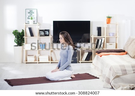 Woman Is Doing Fitness At Home On Her Living Room FloorFit Yoga