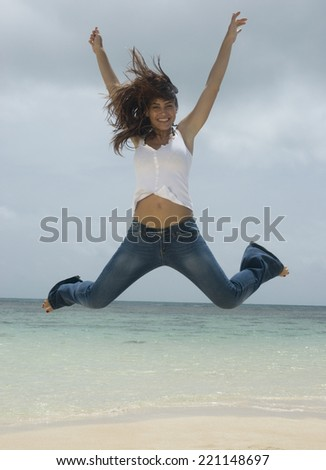 Woman jumping at beach