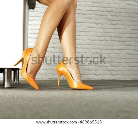 woman legs and sofa in home