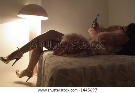 woman  lie and looking in mobile phone