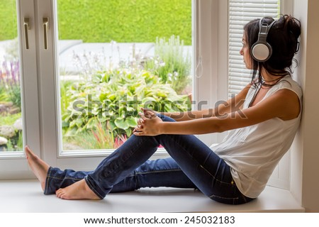 woman listening music with headphones. relax and unwind