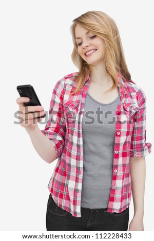 Woman looking at a smartphone against a white background
