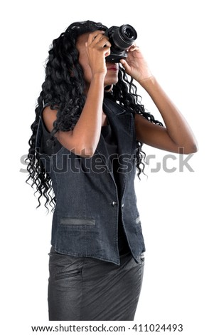 Woman looking at digital camera on white background