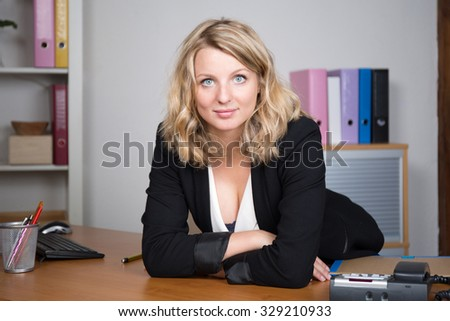 Woman looking at the camera in business place
