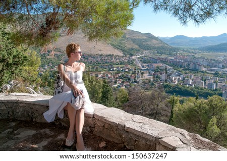 Woman looking down at the City of Trebinje, Bosnia and Hercegovina