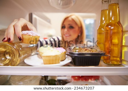 Woman Putting Tv Dinner Into Microwave Stock Photo