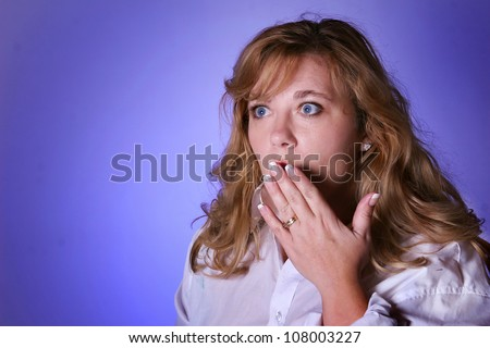 Woman looking surprised or shocking expression. Isolated by a lavender background.Showing manicure.