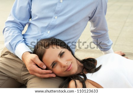 woman lying at mans knees at outdoor