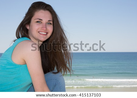 Woman on sunny day in summer at beach