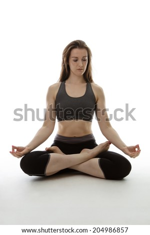 woman on the floor doing her yoga