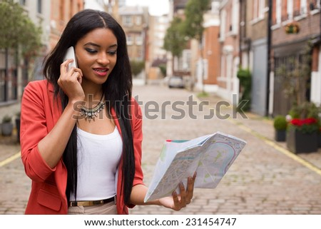 woman on the phone holding a map