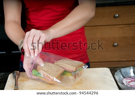 woman packing sandwiches