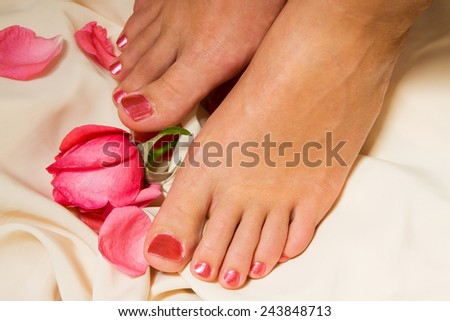 Woman pedicure arranged with rose and leafs