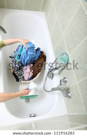 woman Pile of dirty laundry in bath washing machine green bathroom