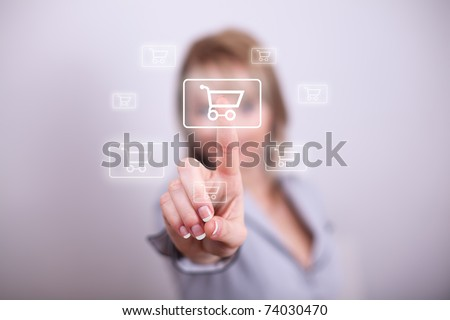 Woman pressing modern shopping cart button with one hand
