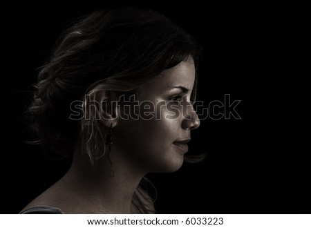 Woman profile on dark background