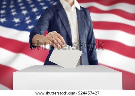 Woman putting a ballot into a voting box with USA flag on background.