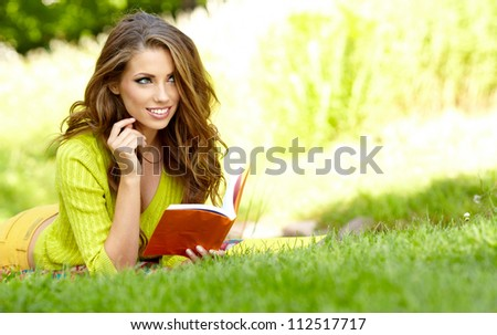 woman reading a book at the lawn