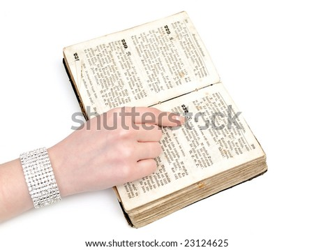 woman reading old book against the white background