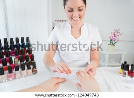 Woman receiving manicure treatment at nail spa