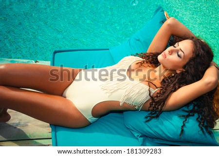 woman relax  by the pool take sunbath sunny summer day