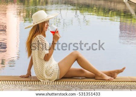 Healthy diet beautiful smiling woman drinking stock photo Outdoor swimming pool crossword clue
